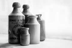 087/365 Steward & Patteson Ginger Beer... (+Pattycake+) Tags: bw stilllife vintage ceramic ginger bottles norwich pottery 365 gingerbeer vintagebottles primelens 087365 ef40mmf28stm 365the2015edition stewartpatteson blackandwhitestewardpatteson