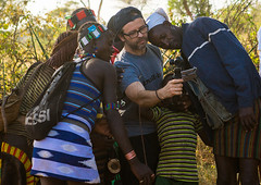European tourist showing the screen of his camera to hamer tribe people, Omo valley, Turmi, Ethiopia (Eric Lafforgue) Tags: africa camera travel people color tourism horizontal demo outdoors togetherness technology exterior looking adult redsea picture culture lifestyle tribal tourist adventure western innocence sharing omovalley leisure ethiopia cheerful tribe showing share hamer hornofafrica eastafrica thiopien etiopia abyssinia ethiopie etiopa westerner  turmi etiopija ethiopi  etiopien etipia  etiyopya          ethio163770