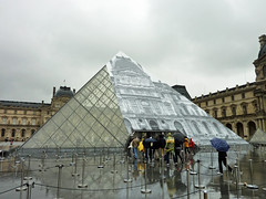 The Louvre pyramid looks different on this rainy day (Monceau) Tags: different pyramid louvre workinprogress jr surprise disappearing