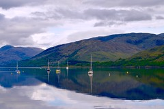 Morning Reflections (rustyruth1959) Tags: morning light sky mountains green nature water clouds reflections boats scotland nikon outdoor calm hills highland serene yachts loch nikkor masts buoys fortwilliam moorings lochlinnhe nikond3200