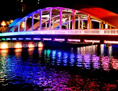 Bridge in colour. (brinthaloganathan) Tags: nightphotography bridge colors night reflections river lights rainbow singapore colours clarkequay singaporeriver