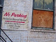 No Parking, Minneapolis, MN (Robby Virus) Tags: minnesota sign no parking lot minneapolis faded will cedar signage be beyond asphalt tow towing violators towed