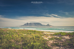A view of the Table Mountain (Chiara Salvadori) Tags: ocean africa travel winter light sea sun seascape beach colors landscape southafrica spring scenery surf outdoor wave capetown atlantic traveling tablemountain capepeninsula sudafrica bigbay