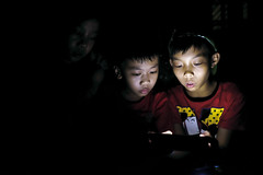 Smartphone - 16 (-clicking-) Tags: life childhood night children child nightshot streetphotography streetportrait streetlife vietnam smartphone nightlight dailylife childish childlike vietnamesechildren