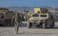 FORT IRWIN, Calif. - A U.S. Army Soldier, assigned to 2nd Armored Brigade Combat Team, 1st Infantry Division, from Fort Riley, Kan., guides a humvee through a staging area during Decisive Action Rotation 15-06 at the National Training Center here, March 1 (Operations Group, National Training Center) Tags: california usa america training army us ks calif soldiers operations troops mohave fortriley fortirwin combatcamera nationaltrainingcenter 1stinfantrydivision sgtjones opsgroup 2ndarmoredbrigadecombatteam combatphotographers vultureteam