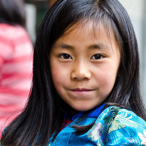 I'm pretty stuck in Denmark at the moment, but just stumbled across my photos from Bhutan, and thought I'd share some. The girl was sitting around in public, waiting for her mother to finish shopping.