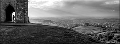 Up on the Tor (zolaczakl) Tags: uk trees england sky blackandwhite southwest landscape mono countryside january glastonbury somerset figure fields mystical hedgerow glastonburytor 2015 somersetlevels stmichaelstower nikond7100 photographybyjeremyfennell