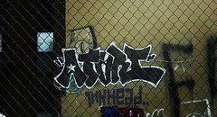 arive - atari - inkhead (timetomakethepasta) Tags: new york city nyc building fence graffiti atari ykk inkhead arive