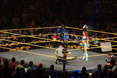 NXT Female wrestlers Sasha Banks holds Womens Championship title overhead as wrestle Charlotte Flair lays on the ground being check on by ref (Eric Broder Van Dyke) Tags: california by female championship check charlotte being sanjose ground womens sasha title lays wrestlers overhead banks flair wrestle wwe holds ref nxt sashabanks charotteflair