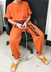 IMG_0531crop (bob.laly) Tags: uniform jail shackles handcuffs prisoner jumpsuit inmate