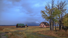 Houses behind the Moulton Barn (Neha & Chittaranjan Desai) Tags: pink autumn usa house fall clouds barn nationalpark hole overcast grand jackson wyoming tetons stucco moulton
