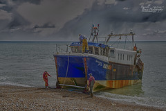 ADSC_7807 (Russell Bruce Photography) Tags: old sea people fish beach broken weather work boats coast town wooden seaside fishing surf waves decay south ships extreme working cliffs landing machinery oil beached british rusting hastings bulldozer