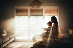 Wrapped in the Morning Rays (amylucinda) Tags: light childhood reading child mother lifestyle rays motherhood