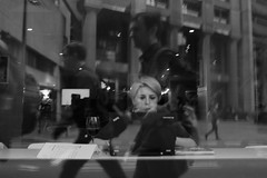 Emails, Wine and Reflection (realjv) Tags: blackandwhite reflection london window monochrome lady wine laptop streetphotography email barbicancentre x100