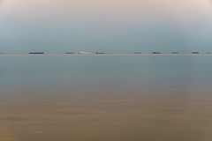 Distant toys (aistora) Tags: pink blue sleeping sea sky orange brown painterly color colour water yellow train reflections boats toys evening still beige quiet flat pastel ships horizon peaceful calm chain sleepy tiny serenity serene parked ripples convoy vessels distant subtle anchored toylike