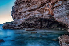 Caves Beach (Rubee Lips) Tags: cavesbeach waves texture rockface beach cave hightide bluewater slowshutter ndfilter