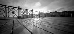 Crosses (DanRSmith) Tags: hastings hastingspier pier pinhole ondu ondupinhole wood planks shadows railings shadowplay shadow sunset fujineopanacros100 rodinal