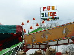 Fun Slide And Kangaroo Ride. (dccradio) Tags: carnival wisconsin fun cloudy overcast slide rapids entertainment rides wi amusements tiptop carnivalrides amusementrides springcarnival superslide giantslide communityevent thrillrides wisconsinrapids funslide fairrides amusementdevice mechanicalrides rapidsmall carnivalslide tiptopcarnival tiptopridesandattractions