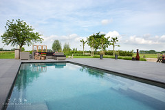 Beautiful Swimming Pools (Stan de Haas Photography) Tags: door new family blue sky white house holiday home window water pool beautiful wall architecture modern swimming private ceramic real outside outdoors day exterior estate chairs suburban lifestyle property australia nobody structure class deck villa queensland tropical leisure mansion residential luxury compass built wealth monoblock prestige compasspools standehaas ceramicswimmingpools