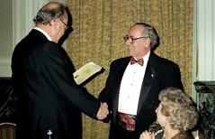 Tony Howlett receives the Irregular Shilling from Tom Stix (photo by Jean Upton)