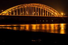 Walbrug Nijmegen (stevefge (away travelling)) Tags: netherlands night nijmegen landscape golden evening shine nederland bridges nederlandvandaag reflectyourworld