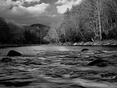 Storm Clearing on the Sacandaga (Mountain Visions) Tags: blackandwhite bw newyork abstract motion water monochrome clouds river flow spring flora pentax hiking wells adirondacks foliage wilderness exploration adirondack adk whiteandblack sacandaga silverlakewilderness pentaxhdda1685mmf3556eddcwr