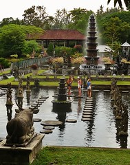 standing in a pond (SM Tham) Tags: trees people bali plants indonesia outdoors island pond asia landscaping statues bull tourists pots watergardens steppingstones fountains waterfeature landscapearchitecture pedestal waterpalace karangasem tirtagangga amlapura gardenstosee