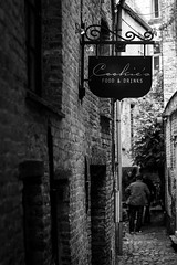 Little Alley (Thomas Demeulemeester) Tags: houses bw men byn outdoors day faades brugge tourists urbanlandscape pavements blackwandwhite advertisingsign littlealley