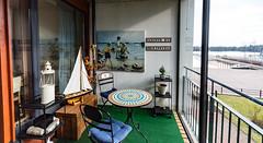 Asunto Oy Meripoika (Jori Samonen) Tags: plants finland painting table boat helsinki model chairs balcony trunk sail lantern vuosaari