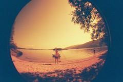 Beach (whatkeirasaw) Tags: scotland lomo lomography fisheye lochlomond redscale fisheye1 scottishsummer whipcrack