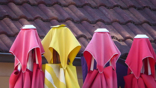 Four Folded Umbrellas