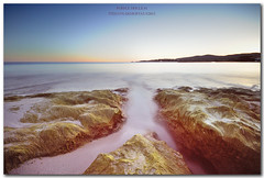 PurpleTrickle#1 (NikFly65) Tags: sardegna sunset sea italy seascape color colour beach nikon rocks long exposure tramonto mare sardinia purple sigma wave 1020 spiaggia onde alghero scogli trickle d90 bombarde nikfly stefanodemurtas