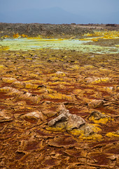 The colorful volcanic landscape of dallol in the danakil depression, Afar region, Dallol, Ethiopia (Eric Lafforgue) Tags: africa travel lake color tourism nature pool vertical landscape outdoors volcano spring colorful day desert natural earth acid surreal nobody nopeople formation heat minerals environment sulphur geography geology ethiopia hotspring volcanic saline geothermal arid ecosystem hornofafrica afar eastafrica thiopien geological etiopia abyssinia ethiopie etiopa  etiopija ethiopi  etiopien etipia afarregion  etiyopya  dallol   danakildepression       ethio161905