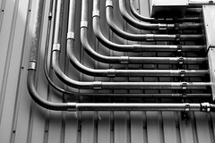 Wires and pipes on the wall in Yamashina station, Kyoto. (sunnywinds*) Tags: leica lines architecture wire pipe  monochrom ilfordxp2    aposummicronm1250asph mm246