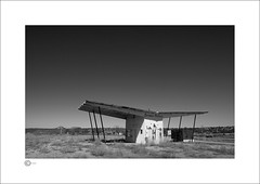 The Station I (Clicker_J) Tags: lighting light bw white building metal architecture america landscape utah blackwhite sand nikon shadows naturallight eastern highlight