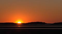 Daybreak at the beach. (athrasher) Tags: morning light sky orange sun reflection beach water sunrise sand day hills