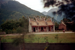 32-013 (ndpa / s. lundeen, archivist) Tags: nick dewolf nickdewolf 32 reel32 color photographbynickdewolf 1970s 1972 fall film 35mm winter republicofchina taiwan taiwanese eastcoast easterntaiwan hualien hualiencounty coast coastaldrive hualiencoastaldrive hills mountains building buildings road people easterncoast ornate architecture china chinese 1973