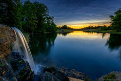 Summer Serenity (Jonathan Tasler) Tags: trees sunset lake reflection waterfall pond missouri thousandoaks plattecounty