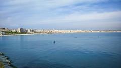 الرمل الجنوبي (nesreensahi) Tags: latakia landscape syria siria syrie sky sun sea waves nature beach blue buildings boats اللاذقية سوريا سورية