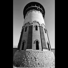 Riverside Water Tower (Eva O'Brien) Tags: trees winter blackandwhite snow cold building brick nature monochrome architecture illinois nikon midwest riverside watertower bnw chicagoland nikond3100 evacares evaobrien