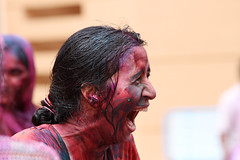 Laughter (saish746) Tags: new girls portrait india playing man color colour male water colors girl smile festival fire evening other colorful faces little spirit delhi indian prayer bangalore together laughter colourful splash hindu hinduism holi each choti dahan holika dhahan lplaugh