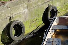 La barque (Martin Mollicone) Tags: wood water amsterdam la canal eau fuji pierre rope un sur fujifilm pierres paysbas pneu bois barque roue planches corde xm1 boue