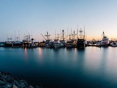 Calm state (DavidChege) Tags: ocean longexposure water landscape boats dusk slowshutter