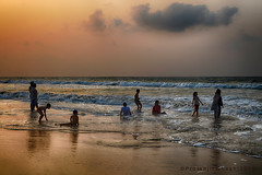 Playing in sea (Prosenjit Ghosh) Tags: light sea people cloud beach beautiful sunrise kid nikon play joy wave