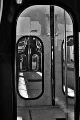 Sliding doors (Mango*Photography) Tags: street city travel light urban bw white black travelling love station photography doors artistic gray photographers shades destiny sliding choices serendipity choose giulia trai slidingdoors bergonzoni giuliabergonzoni