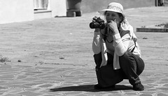 Patiently waiting for the shot (Just Ard) Tags: street people blackandwhite bw woman white black blancoynegro monochrome face hat person photography mono nikon waiting photographer noiretblanc zwartwit candid d750 unposed  biancoenero squatting 24120mm schwarzundweis justard