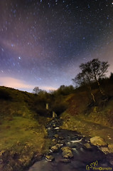 Waterfall by Starlight (Gavmonster) Tags: longexposure trees sky white mountains green water wales clouds stars landscape waterfall nationalpark moss nikon rocks outdoor tripod wideangle breconbeacons land milky startrails northstar polarisingfilter 1024mm d7000 nikond7000 extremelongexposure 5minutesexposure gswphotography