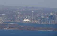 Toronto. The city as one flies into Toronto CIty Airport. The Billy Bishop Airport. The CN Tower at over 555 metres is the world's talled free standing structure. (denisbin) Tags: city lake toronto tower airport cntower skyscrapers lakeontario
