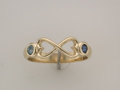 Heart infinity ring in 14kt yellow gold set with blue zircon and blue sapphire