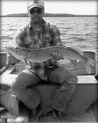 049 (Marbeck53) Tags: trip travel vacation lake fish man male water canon person boat fisherman shades manitoba esoxlucius human cap thepas northernpike clearwaterlake marbeck53 markriesenbeck